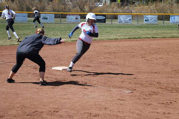 McKenna Purdy rounds third as Coach Ashely Post looks on during Saturday's win over South Tahoe.