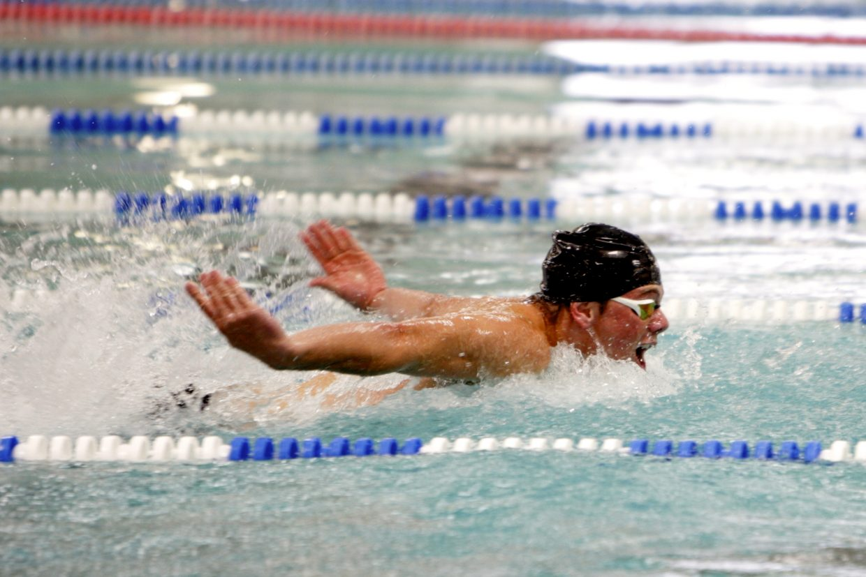 Cooper de Ryk swims to first place in the 100-yard butterfly.
