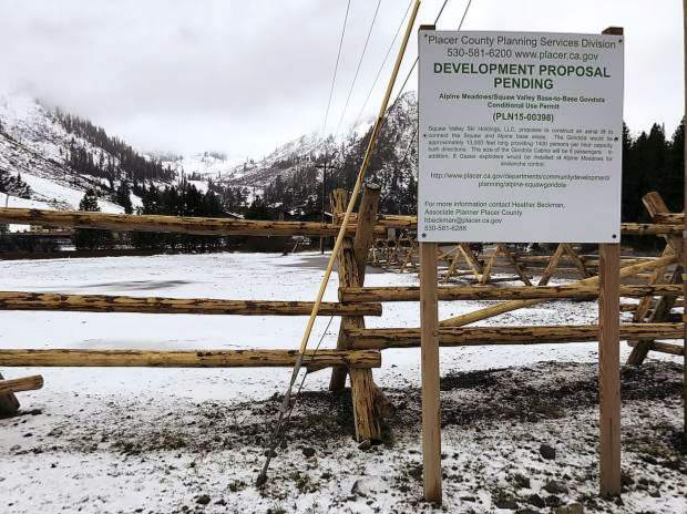A sign is posted announcing the pending development plans at Squaw Valley.