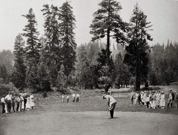 A player lines up a putt during the early days of the course.