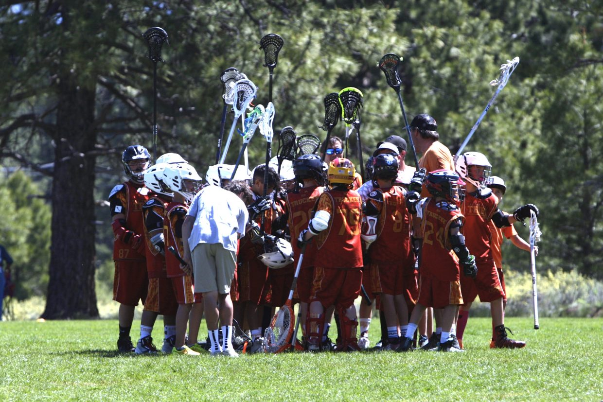 Truckee's 12-and-under boys' team huddles up after falling to South Reno in the tournament championship game at Riverview Sports Park on Sunday, June 3.