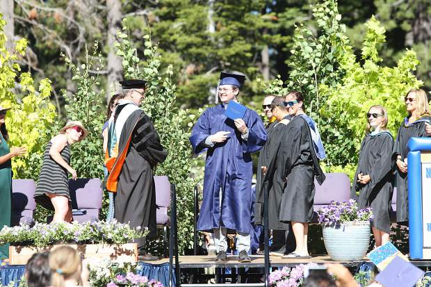 Steven Drake receives his diploma.