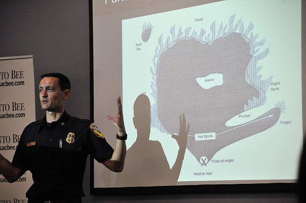 Cal Fire PIO Jonathan Cox demonstrates how a wildland fire operates during a recent media wildfire training held at the Sacramento Bee.