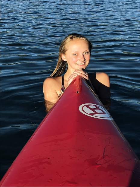 Native born Truckee girl Hailey, paddle boarding in the Boca at sunset.