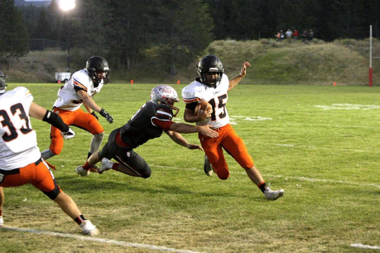 Senior linebacker Sean Kelly dives to bring down Fernley quarterback Cooper Henderson.
