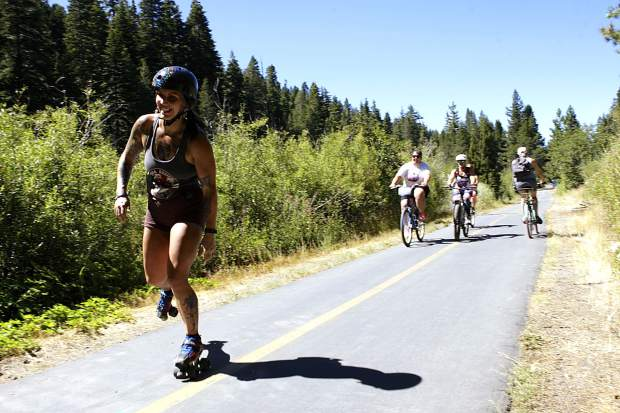 Nearly 100 participants on skateboards, longboards, bicycles, rollerblades, and scooters helped raise funds as part of this year's Skate the Lake.