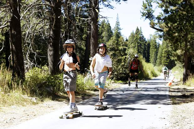Skaters roll along a section of trail between Squaw Valley and Tahoe City.