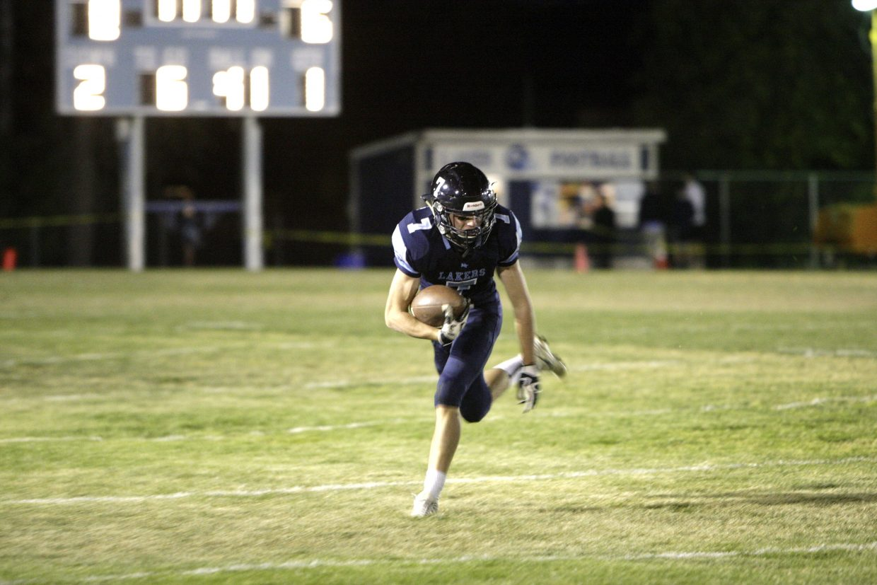 Senior captain Tony Frankenberg rushes the ball against White Pine on Friday, Sept. 29.