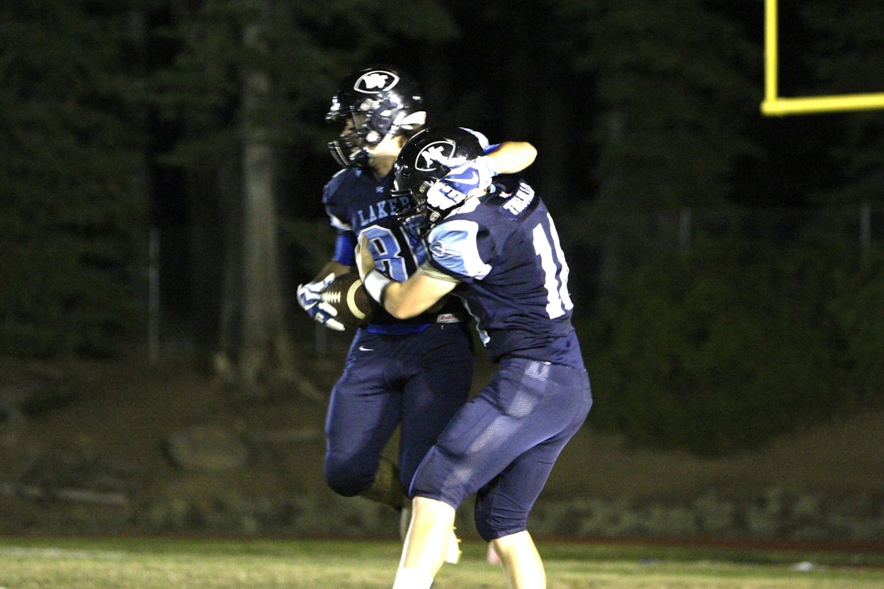 Ben Trujillo (No. 10) and Stephen Lopez celebrate a North Tahoe touchdown.