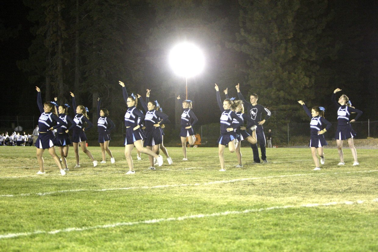 Cheerleaders perform during halftime of homecoming on Friday, Sept. 28.