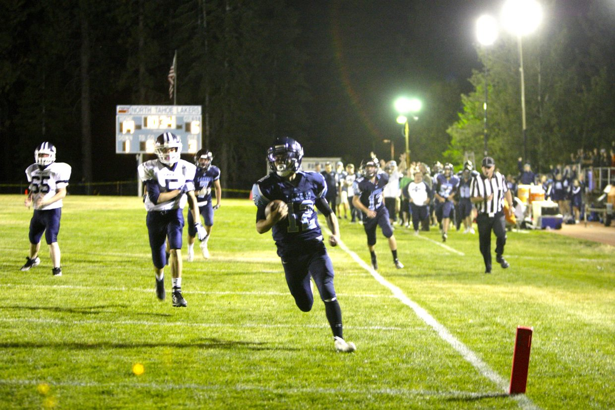 Quarterback Thomas Mercogliano threw for three touchdowns and ran for four more against White Pine.