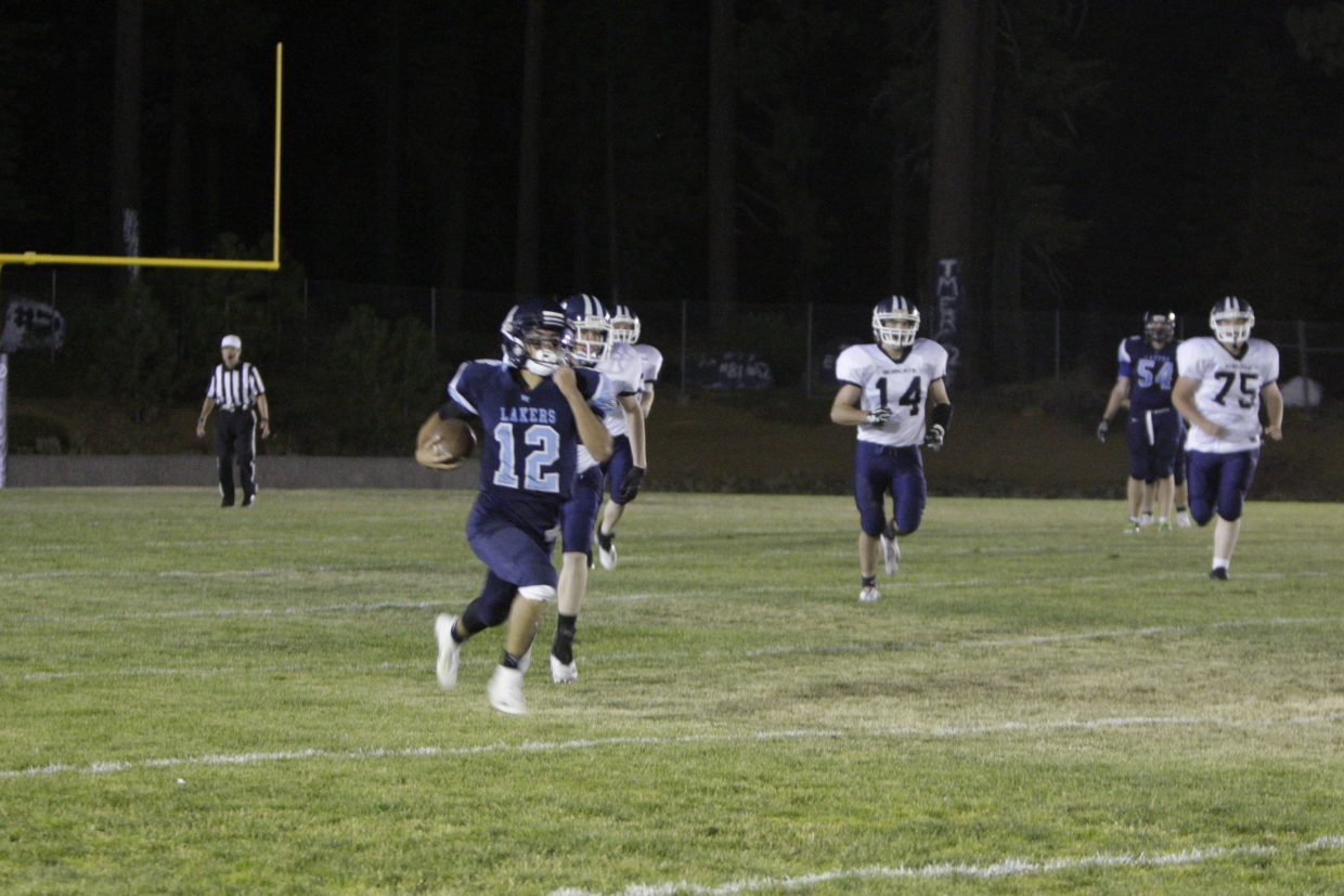 Senior quarterback Thomas Mercogliano breaks free for one of his four rushing touchdowns.