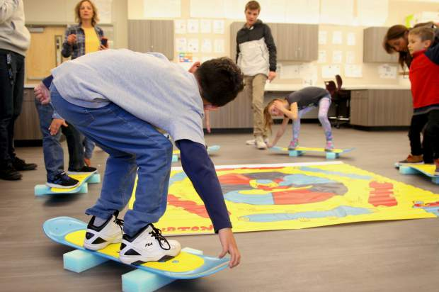 Truckee High School's new Gone Boarding class got a visit from Truckee Elementary School students on Wednesday. The younger students got to design their own board graphics and test their balance on foam snow boards.