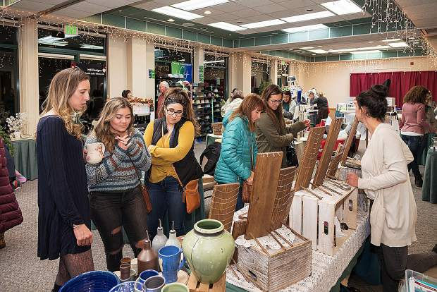 Folks shop local at the Local Business Holiday Market.