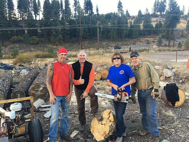 Annually the Truckee Rotary spends many nights splitting firewood for seniors and others in our community. This year 12 cords were delivered. Rotarians, Billy Watters, left, Randy House, Janine Irwin-Webb and Bill Quesnel hard at work.