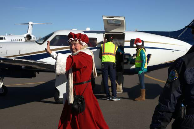 Santa and Mrs. Claus flew into the Truckee Tahoe Airport over the weekend to hand out toys and take pictures with children who welcomed them at the hangar.