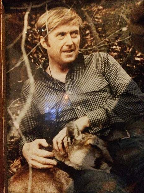 Bill Newsom and his cat.