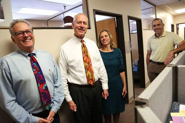 Outgoing Nevada County Sheriff Keith Royal is surrounded by some of his dedicated office staff members last week at the Eric Rood Administrative Center in Nevada City.
