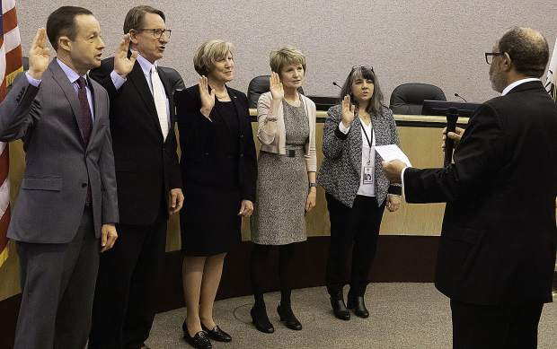 Left to right, Superintendent of Schools Scott Lay; District Attorney Cliff Newell; Auditor-Controller Marcia Salter; Assessor Sue Horne; and Treasurer-Tax Collector Tina Vernon. Gregory Diaz, clerk-recorder/registrar of voters, administers the oath.