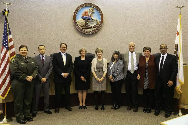 From left to right, Shannan Moon; Scott Lay; Cliff Newell; Marcia Salter; Sue Horne; Tina Vernon; Dan Miller; Susan Hoek; and Gregory Diaz.