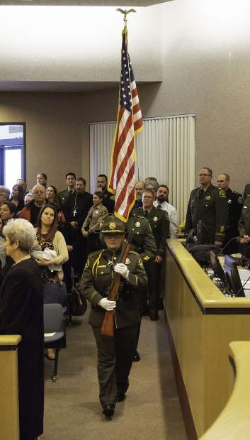 The Nevada County Sheriff's Honor Guard presents the American and California flags before the swearing-in ceremony at the Eric Rood Administrative Center.