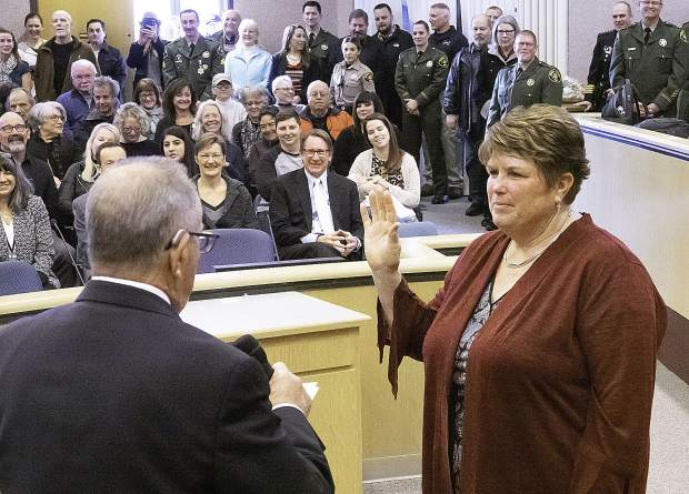 Swearing in newly elected District 4 Supervisor Susan Hoek by outgoing Supervisor Hank Weston.