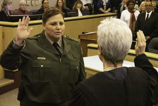 Sheriff Shannan Moon, right, takes the oath of office administered by the Honorable Associate Justice M. Kathleen Butz, California Third District Court of Appeal.