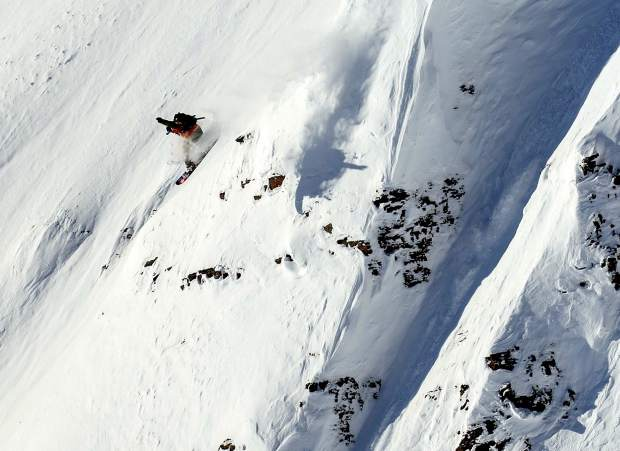 Sammy Luebke launches off a feature at Kicking Horse.