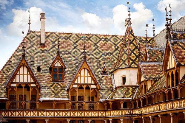 Burgundy may be the most well-known wine region on earth. Since the mid-1400s the multicolored mosaic tiled roof of the Hôtel-Dieu de Beaune. or Hospices de Beaune, a hospital which is the beneficiary of a fabled wine auction held each November, serves as an enduring visual symbol for a place in wine, Burgundy.