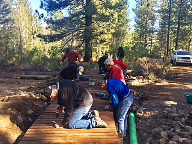 Serving our community, Rick McConn, long-term Rotarian and past president, is accompanied by several Rotarians from The Rotary Club of Truckee on one of the designated Rotary Work Days.