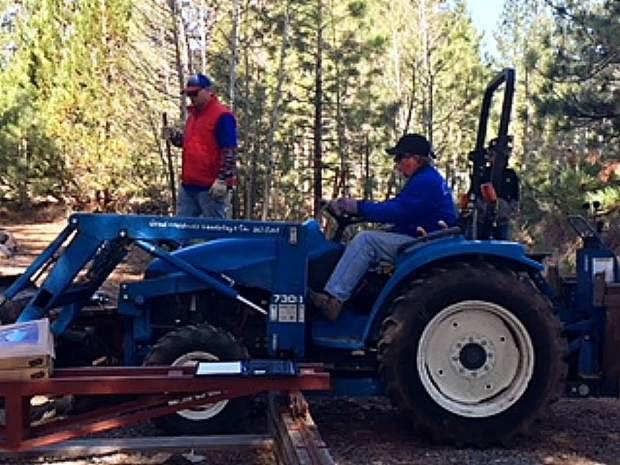 Serving our community, Rick McConn, long-term Rotarian and past president is accompanied by several Rotarians from The Rotary Club of Truckee on one of the designated Rotary Work Days.