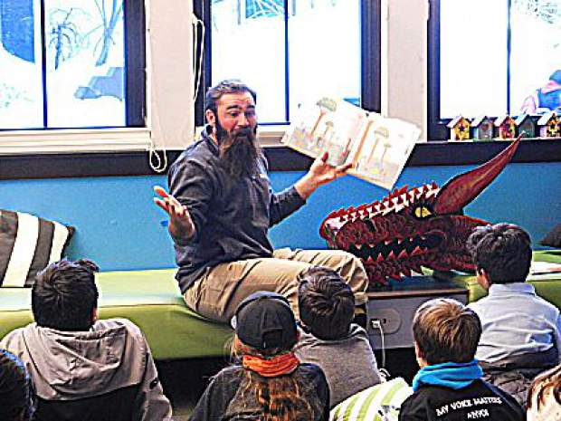 Ben from the Boys and Girls Club reading to a group of kids from Kings Beach Elementary.