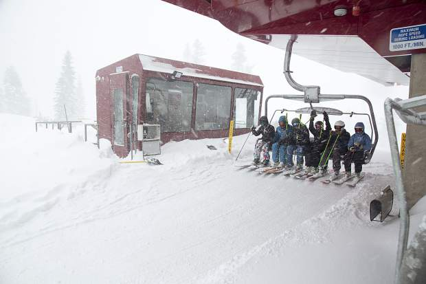 A group of skiers prepare to unload at Northstar California Resort during an early March storm.