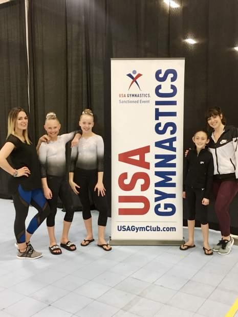 Truckee gymnasts pose after competing at the state championships.