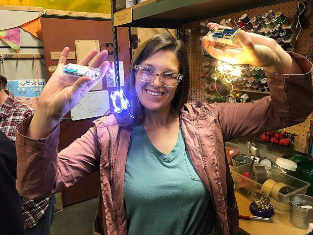 Rachael Coxson with her repaired battery-powered lights.