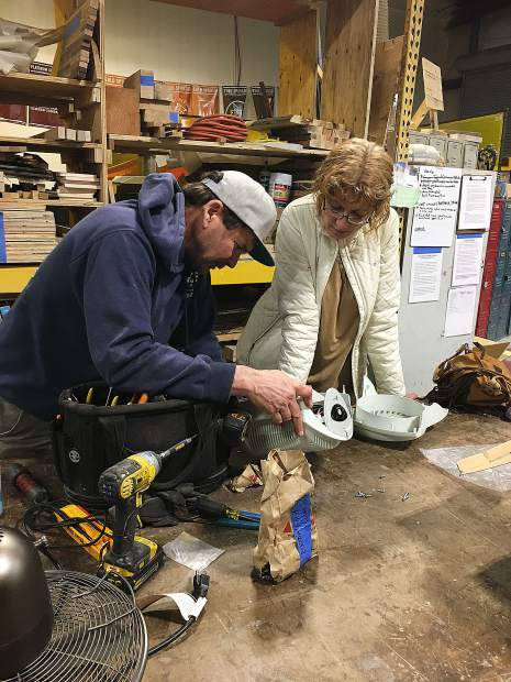 Volunteer Fixit Coach JP Prince helping Bonnie York diagnose a broken space heater. The Truckee Roundhouse partners with the Town of Truckee's