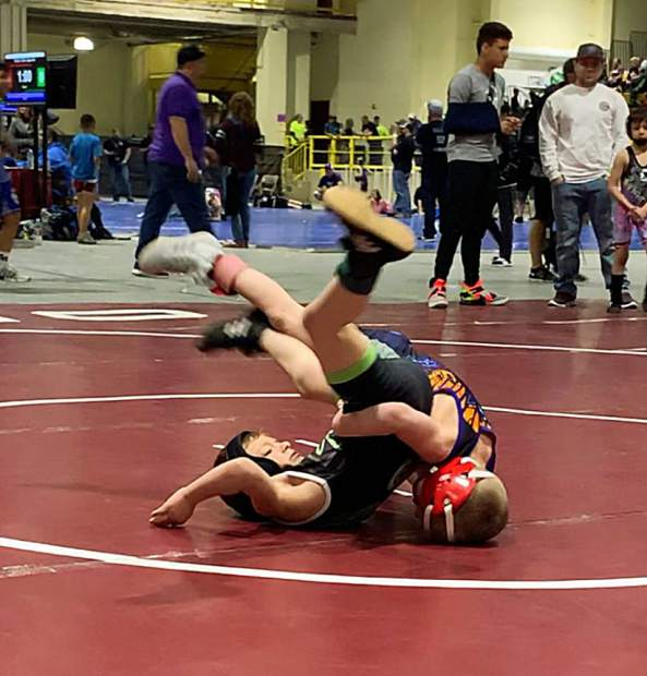 Sammy Svitana takes an opponent to the mat.