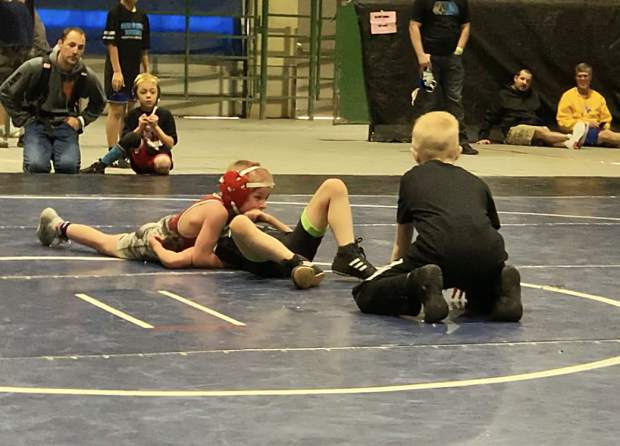 Sammy Svitana looks to pin his opponent.