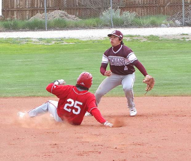 Senior Derek LaFerriere steals second against Elko.