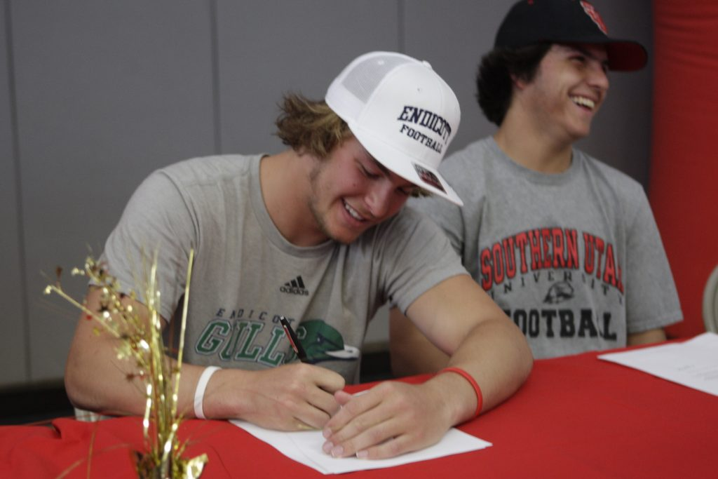 Drew Wingard signs his letter of intent to play football at Endicott University.