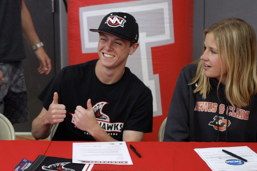 Shane Poe gives the thumbs up after inking his name to attend Northwest Nazarene University.
