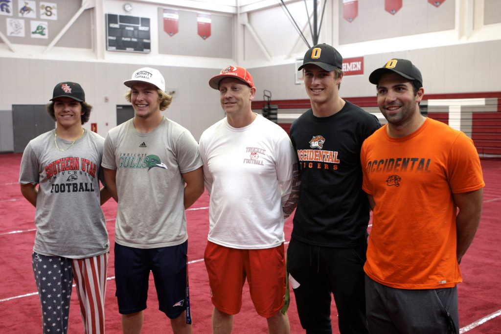 Members of Truckee's football team pose with Head Coach Josh Ivens.