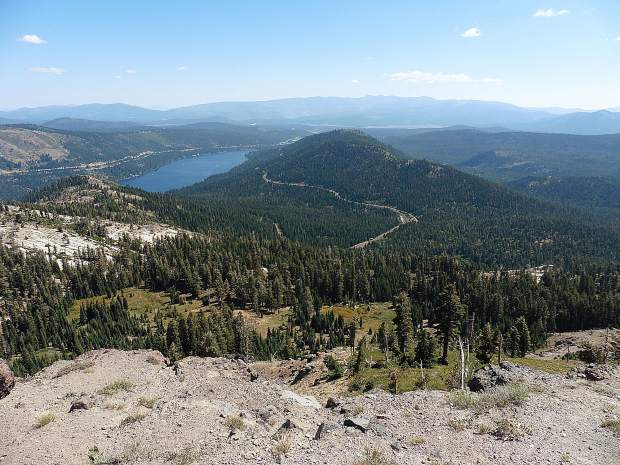 View to the east, with Donner Lake below, from Mt. Judah. In 1869 the railroad was completed using the route Judah had surveyed. Where the wagon trains had taken 4-5 months and stagecoaches 25 days, railroad passengers could cross the whole country in 10 days.