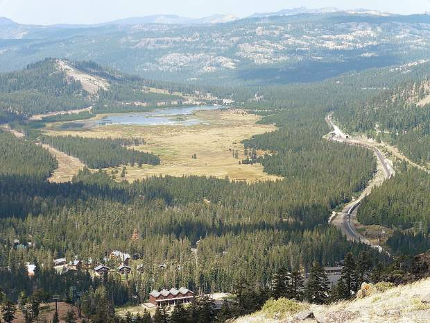 View to the west from Mt. Judah, with Lake Van Norden in the distance. The railroad route followed the easy incline of the Sierra from the west to the summit.