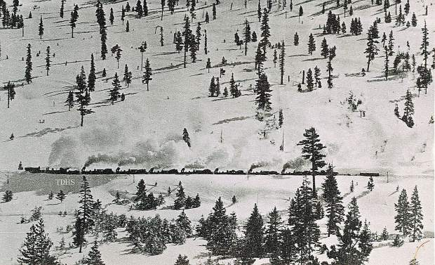 Locomotive engines push a plow in the Coldstream Valley.