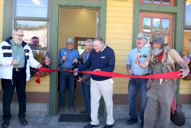 Truckee Mayor David Tirman and Jim Hood of the Truckee Donner Railroad Society cut the ribbon to kick off the celebration of the 150th anniversary fo the Transcontinental railroad.