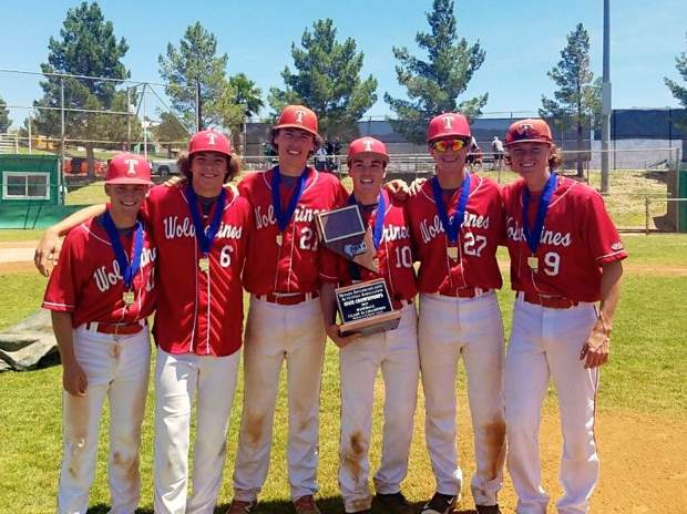 The Truckee players pose after repeating as Class 3A state champions.