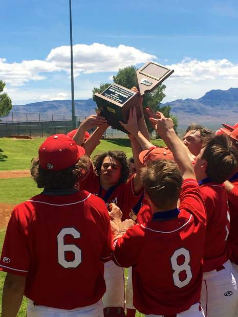 Truckee players hoist the NIAA Class 3A state baseball trophy for a second straight year.