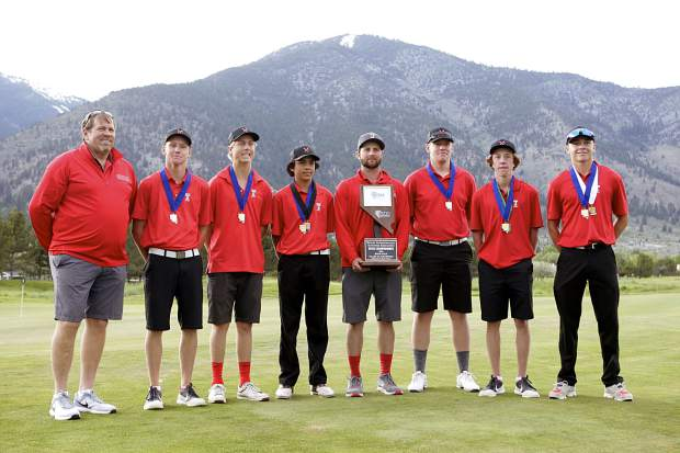 The Truckee golf team poses after winning the Class 3A state championship. As a team, the Wolverines went undefeated this season.