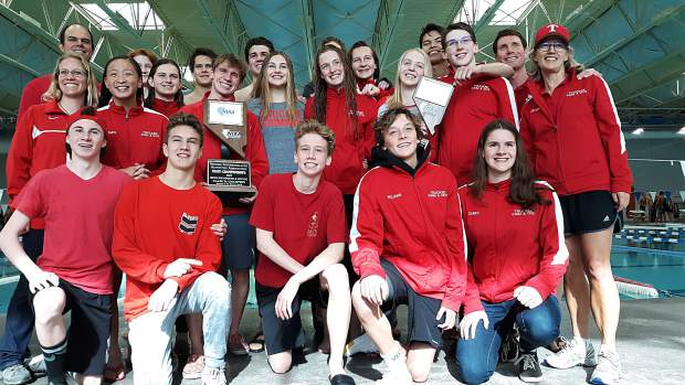 The Truckee swim team poses with the boys' state championship trophy and the girls' second-place trophy on Saturday, May 18.